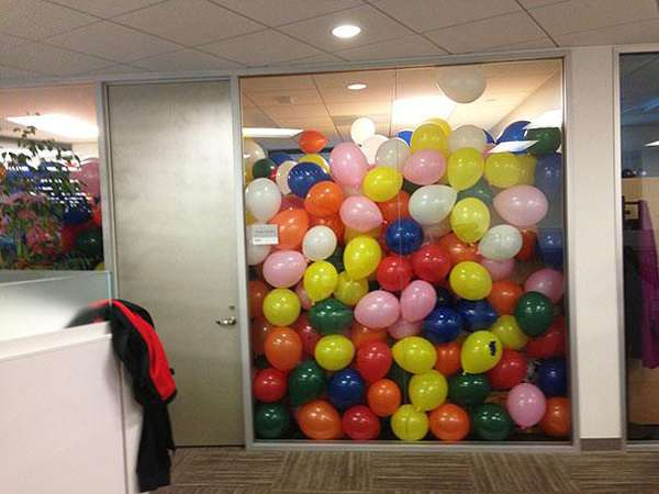 17.) Throw coworkers a surprise party... with extra balloons