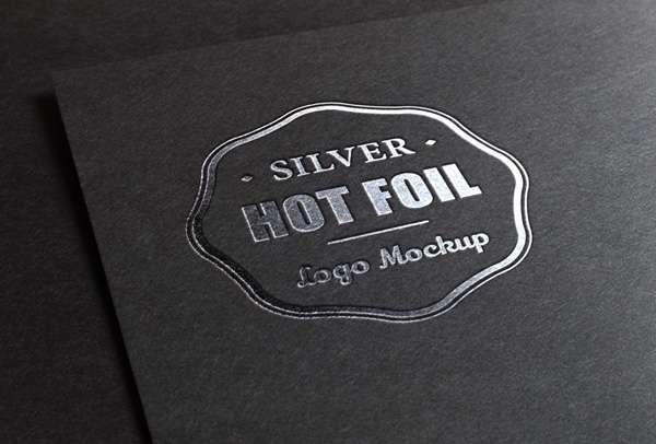Free silver stamp logo PSD mockup.