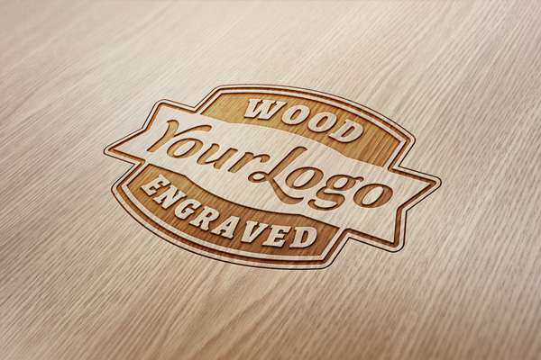 Free wood engraved logo PSD mockup.